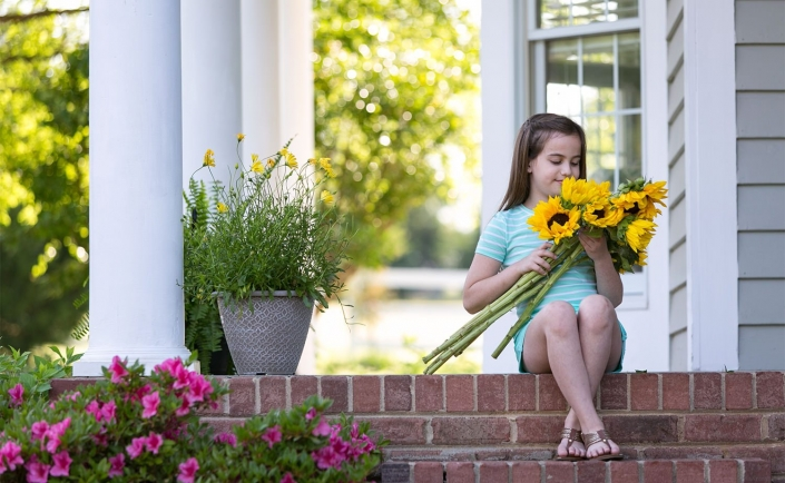 sunflowers-girl-lifestyle-porch