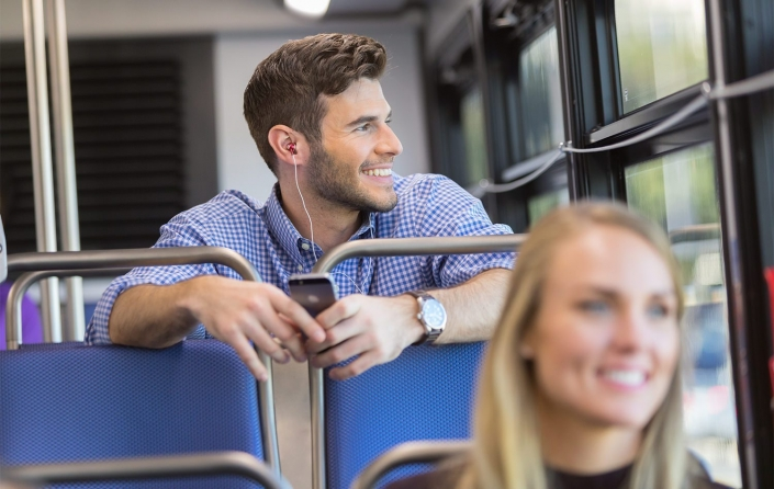 Commercial photographers - happy bus passenger on public transportation in Charlotte, NC