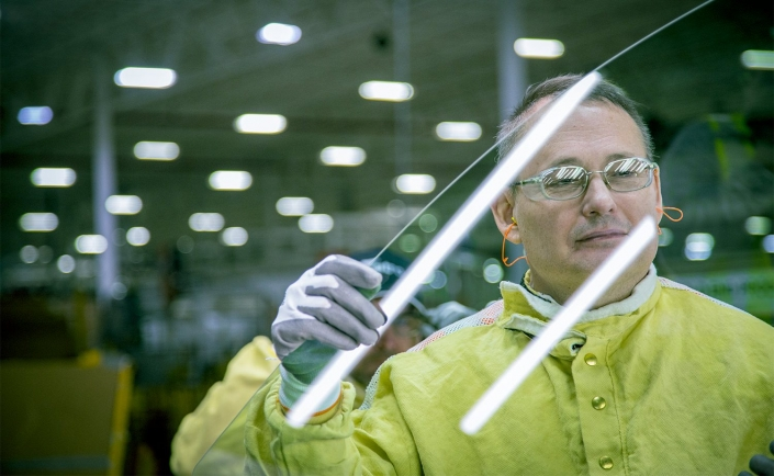 Glass assembly worker in quality control