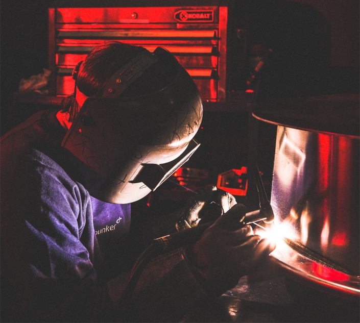 Welder in industrial plant