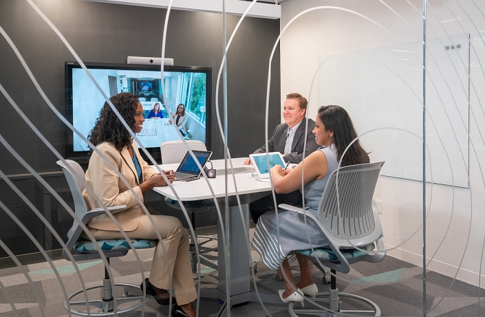 Corporate Lifestyle Photography - Virtual meeting of executives in conference room