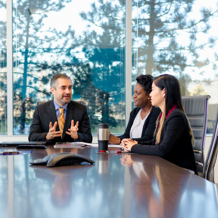 Corporate Commercial Lifestyle Photography - Virtual meeting of executives in conference room