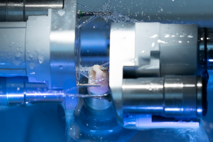 Industrial Photography - Blank mold being formed in machine with water spraying - Manufacturing photography