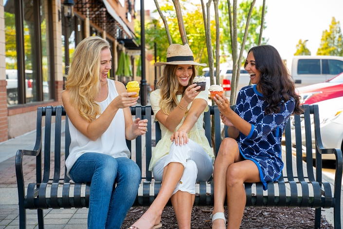 Commercial Lifestyle Photography - 3 women enjoying cupcakes outdoors