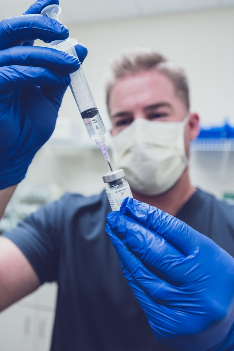 Healthcare Photography - pharmaceutical technician preparing solution for testing