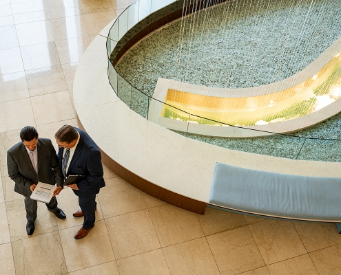 Business Photography - Executives meeting in lobby