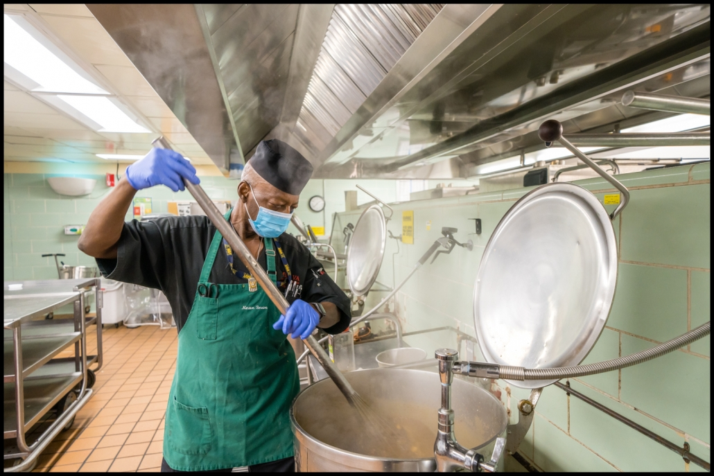 Michael LoBiondo Healthcare Photography Portfolio - Veterans Affairs - Cook stirring soup in large vat