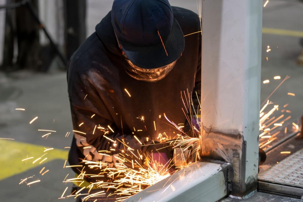 Michael LoBiondo Photography - welding metal for rooftop unit